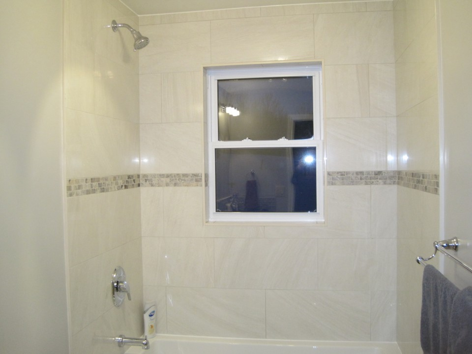 Bathroom with tiled tub surround shower