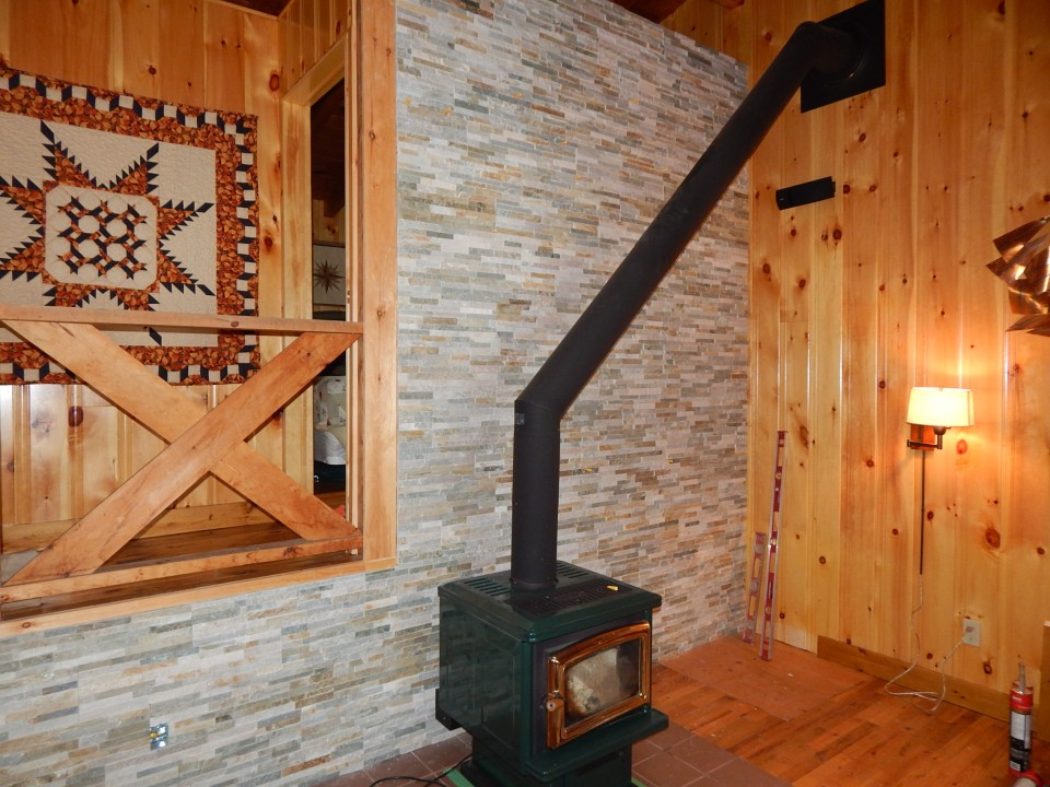 Stacked Stone Veneer behind wood stove.